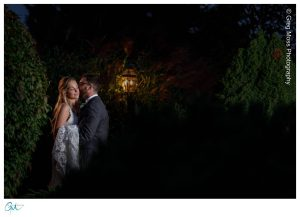 Bride and groom at night on path