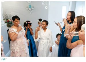 Bride, Mom and Bridesmaids toasting with Champagne