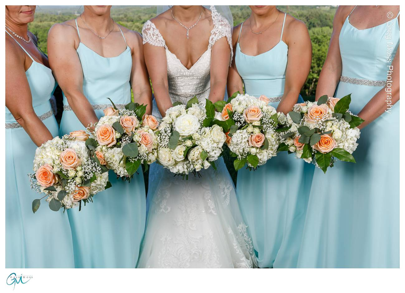 Bridesmaids holding flowers by forget me not florist