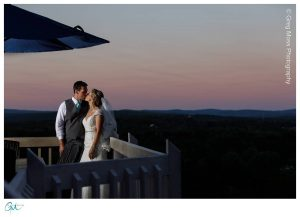 Bride and Groom on Mountain Rose Inn Deck at sunset