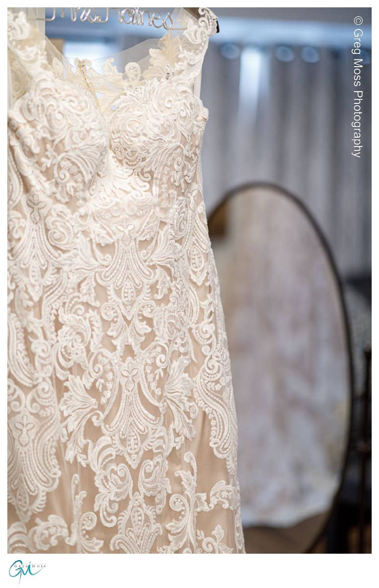 Bride's dress with back of dress in mirror