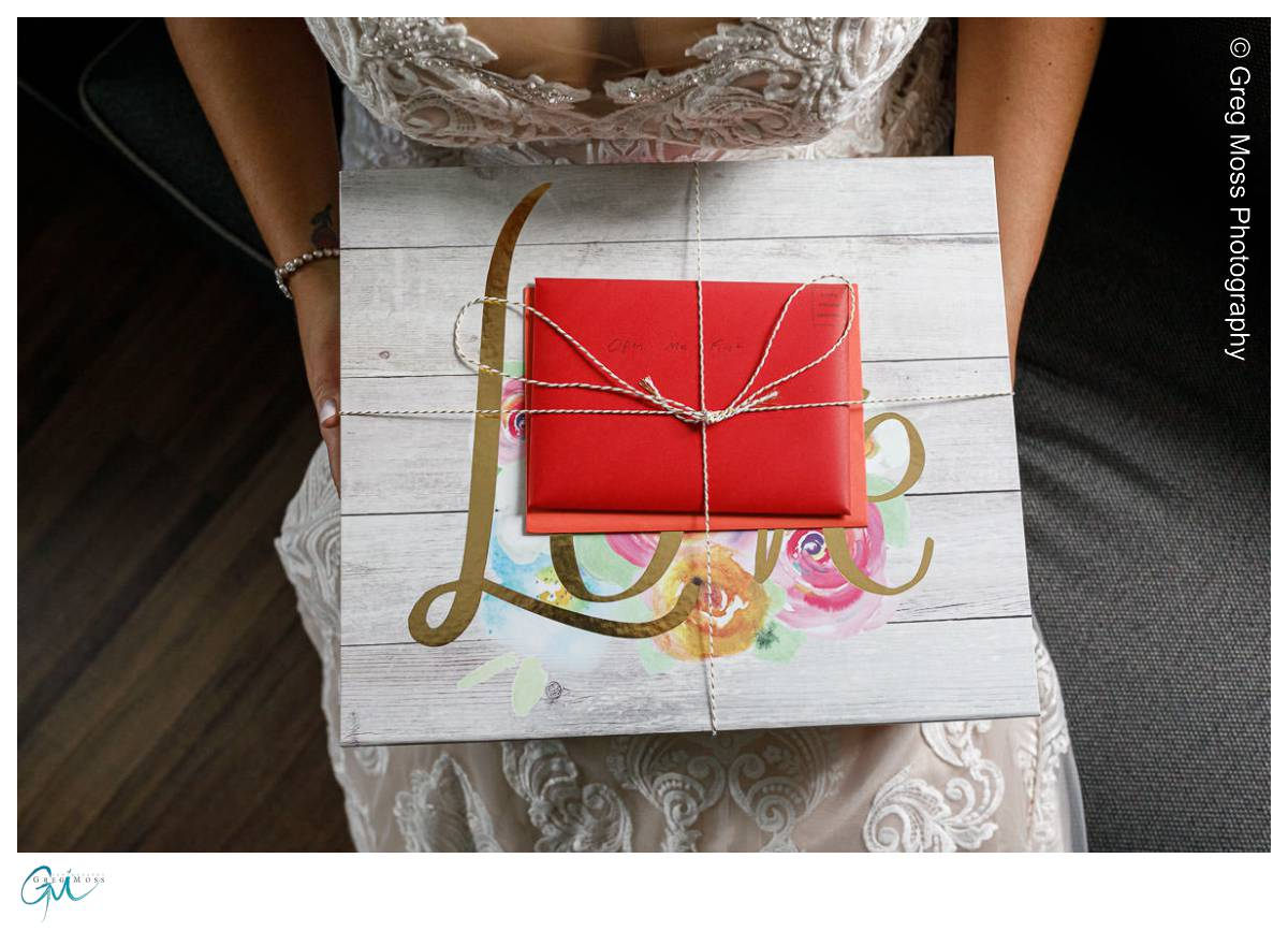 Bride opening gifts from groom