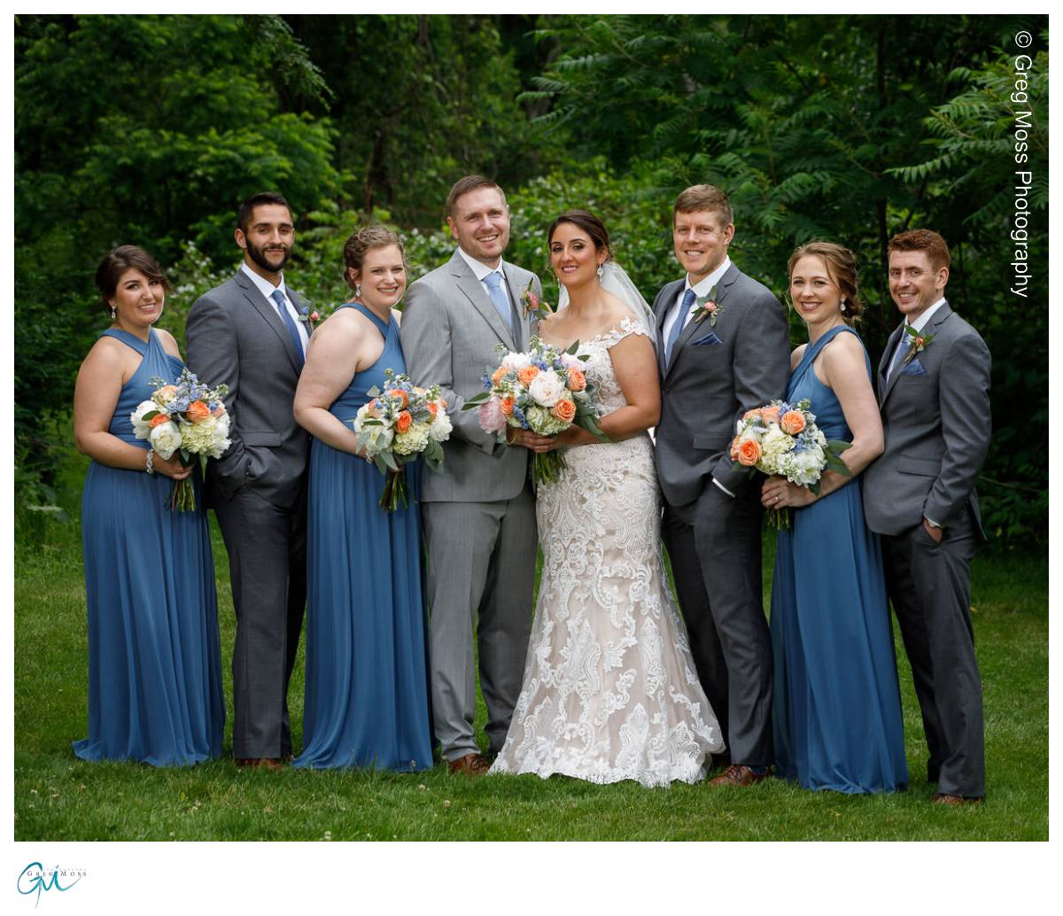 Wedding party surrounded by trees