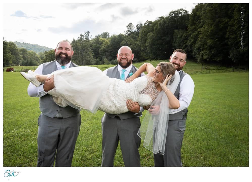 Groom and groomsmen picking up bride.