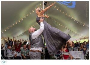 groomsmen and bridesmaid in dirty dancing signature move
