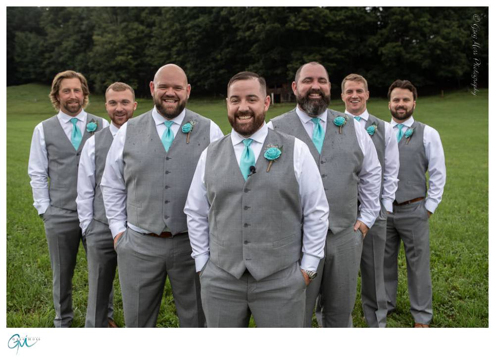 Groom with groomsmen lined up in the flying V
