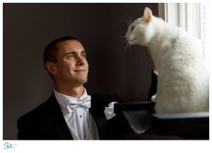 Groom with his white cat