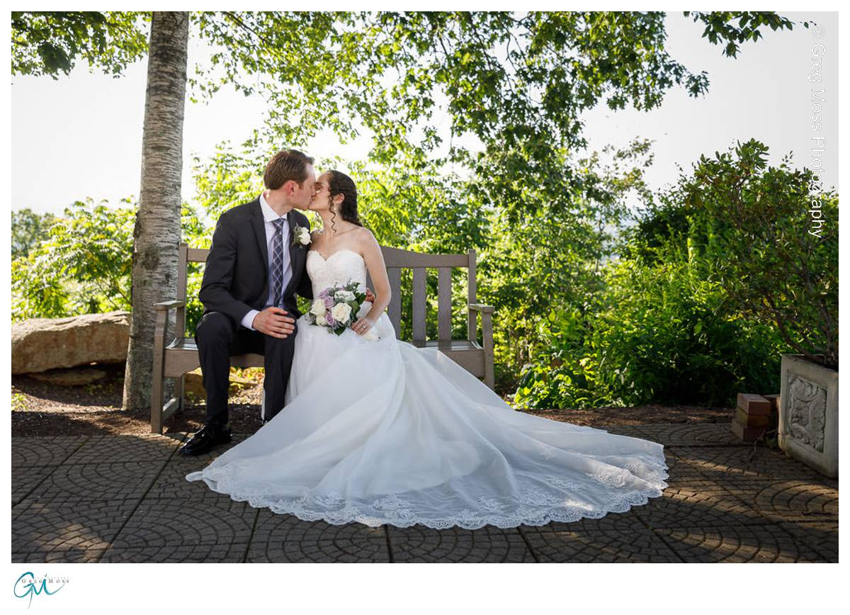 Bride and Groom on Bench in shade