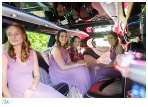 Bride and Bridesmaids in limo headed to the Log Cabin