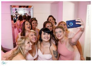 Bridesmaids taking selfie in getting ready room