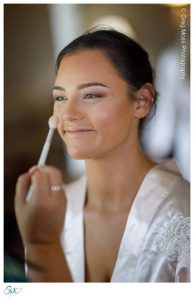 Bridesmaid getting makeup applied