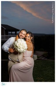 Groom with sister, one of the bridesmaids at sunset
