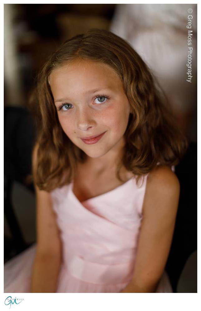Flower girl smiling with pretty eyes