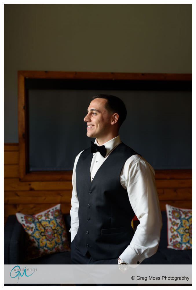Groom on wedding day in bridal suite