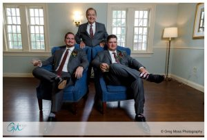 Father of the groom, brother and groom in chairs with rocks glasses