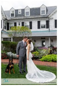 bride and groom kissing in front of the building