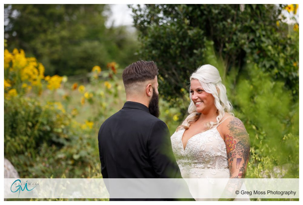 Bride and groom looking at each other during first look in garden at Salem Cross Inn