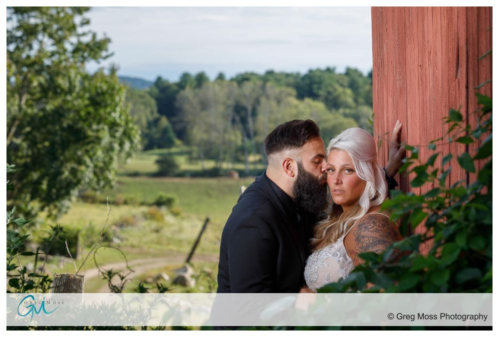 Bride and groom against the Red Barn
