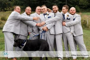 Groom and groomsmen with dog