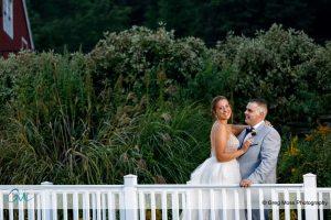 Bride and groom on small bridge.