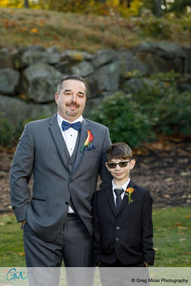 Portrait of Groom and his son on wedding day