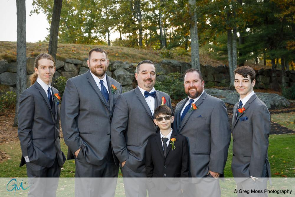 Groom and groomsmen outside at fall wedding