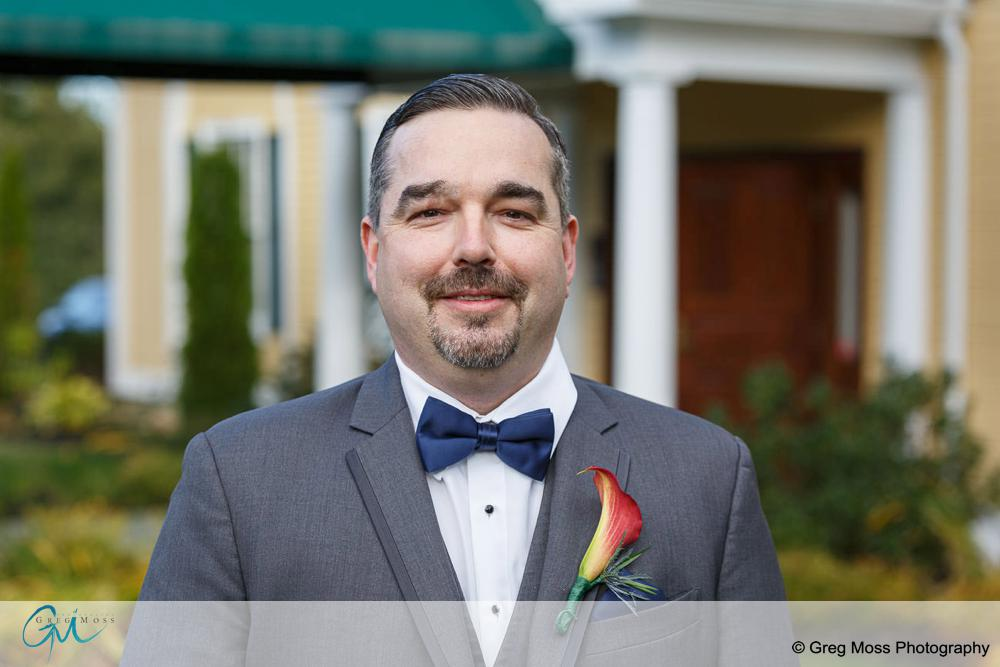 Groom waiting to see bride for first time right before wedding.