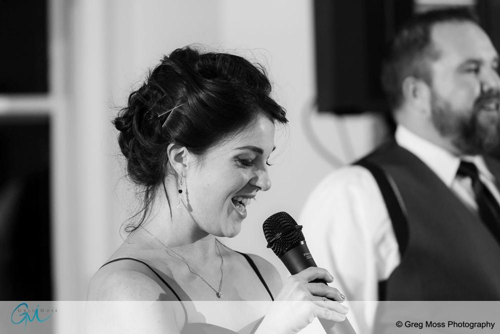 Black and white photo of Maid of honor giving speech