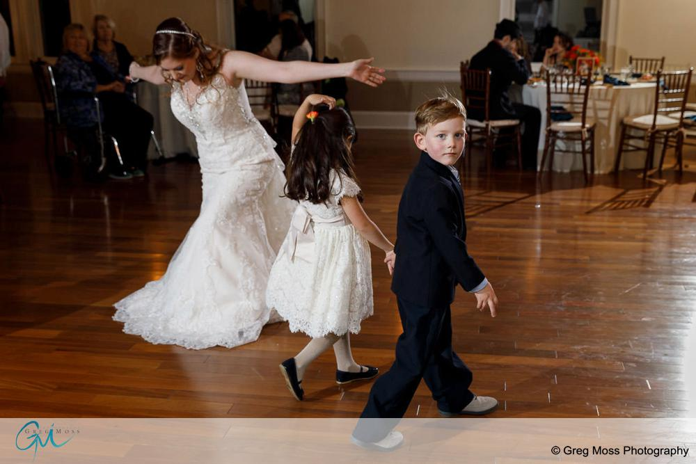 Dancing at wedding reception and two young kids holding hands and walking