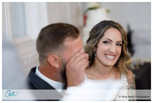 Bride laughing during Best Man's speech during reception