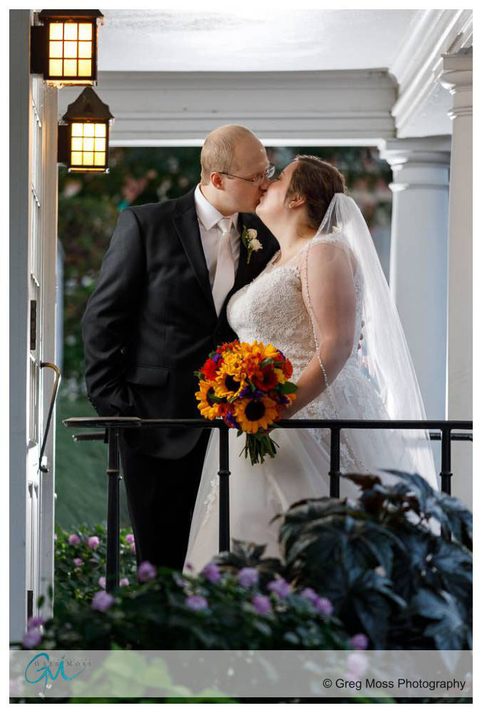 Bride and Groom kissing by side door of the inn on boltwood.