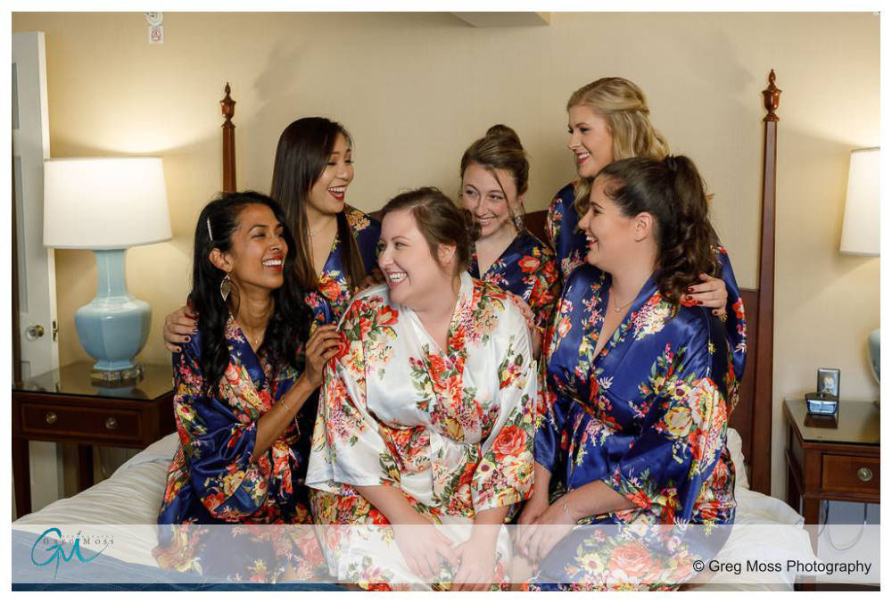 Bride and Bridesmaids wearing matching robes before wedding ceremony