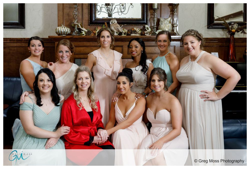 Bride and bridal party posed in lobby of D hotel in Holyoke
