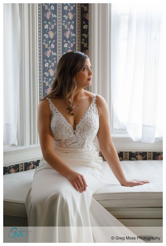 Stunning portrait of a bride in front of bay windos
