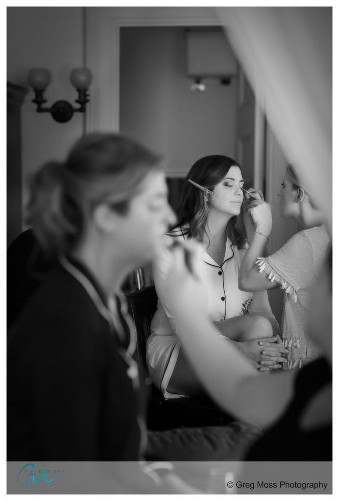 Bride and Maid of honor getting makeup done the morning of the wedding