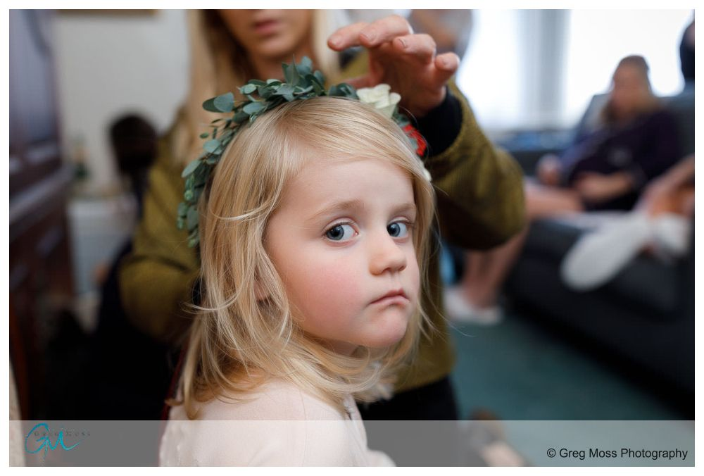 Flower girl getting her flower headpiece adjusted
