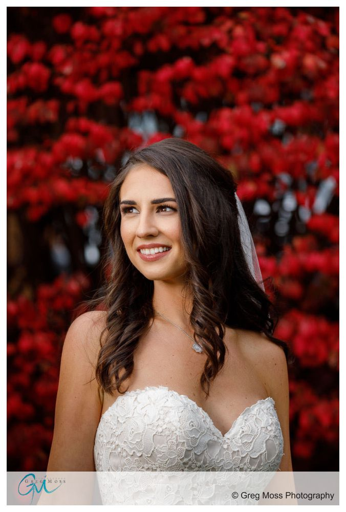 Portrait of bride outside with fire bush in the background