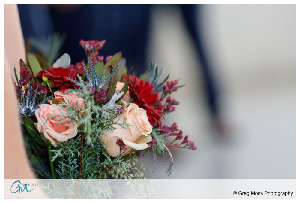 Bridal bouquet being held by maid of honor during ceremony