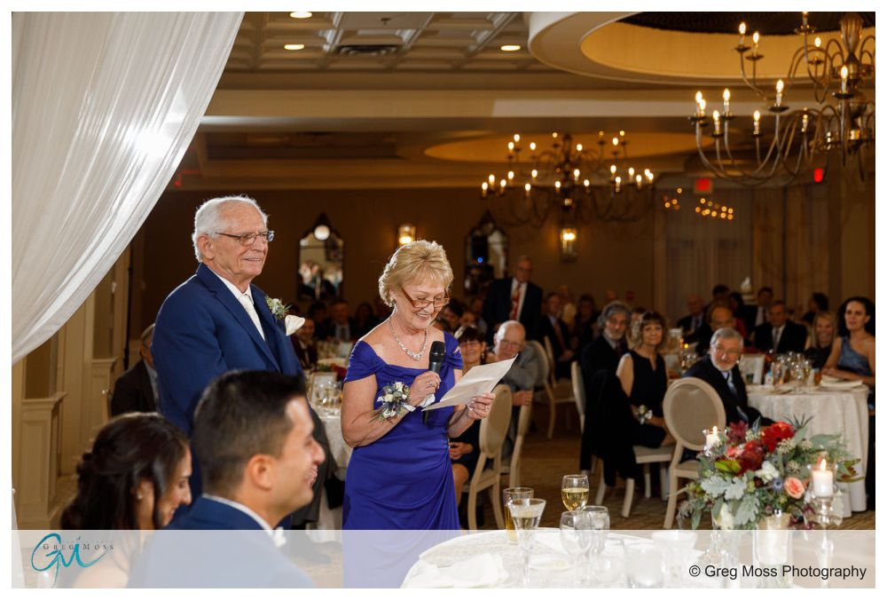 Mother and Father of the Bride reading speech during reception