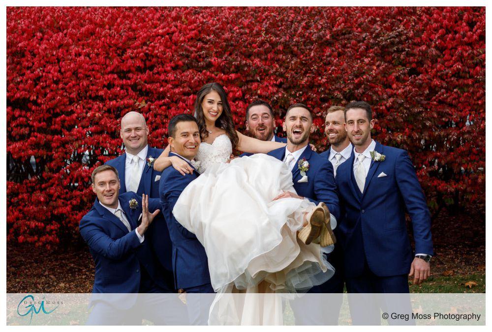Groom and Groomsmen picking up bride