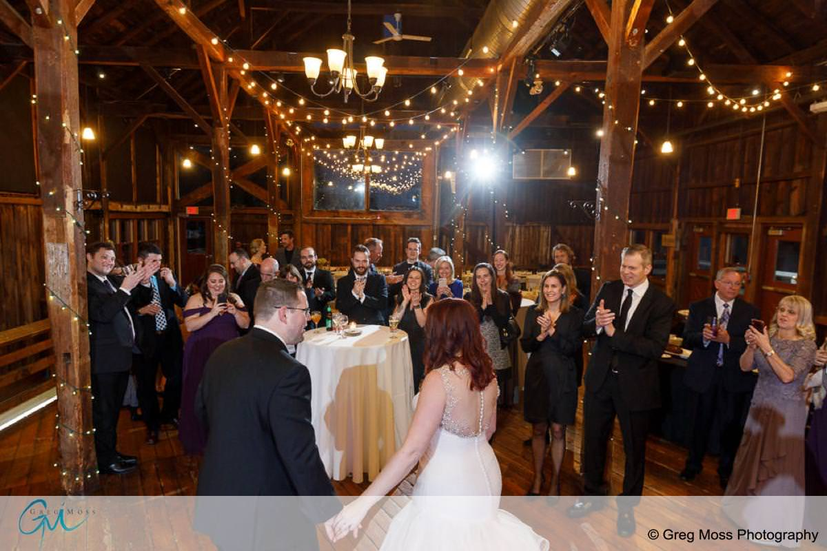 Bride and groom first dance with guests