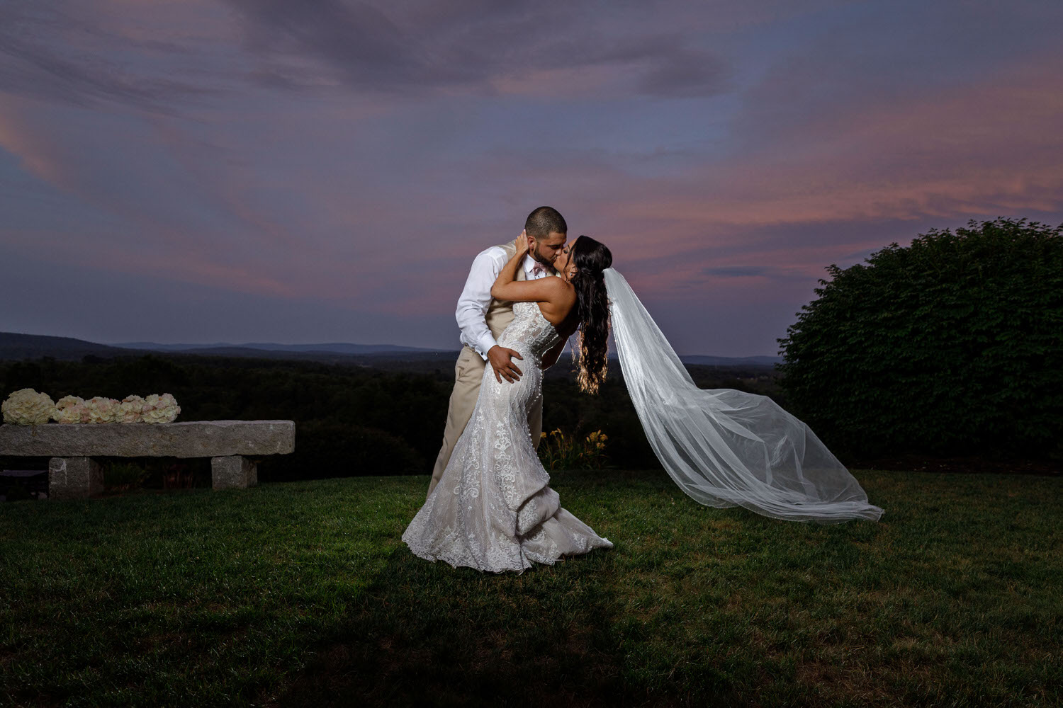 Groom dipping bride at sunset at Mountain Rose Inn