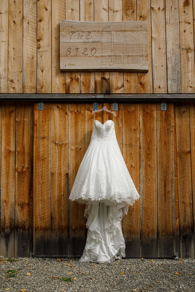 Wedding dress hanging out side on Barn at Wrights Mill Farm