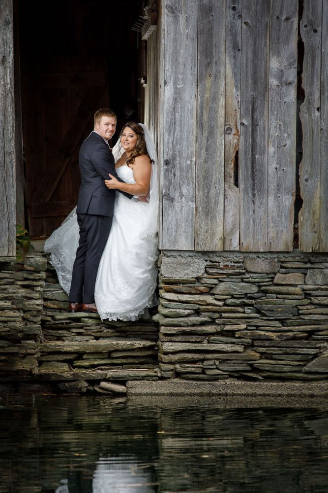 Bride and Groom by water in old farm house at Wrights Mill Farm