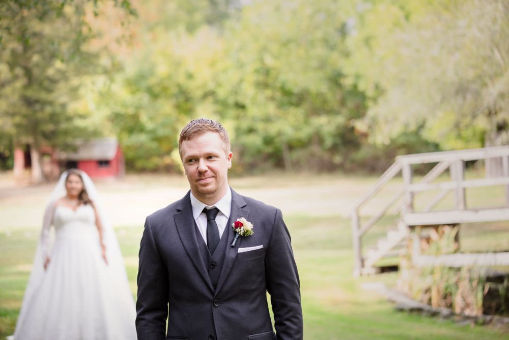 Groom ready for first look in outdoor field