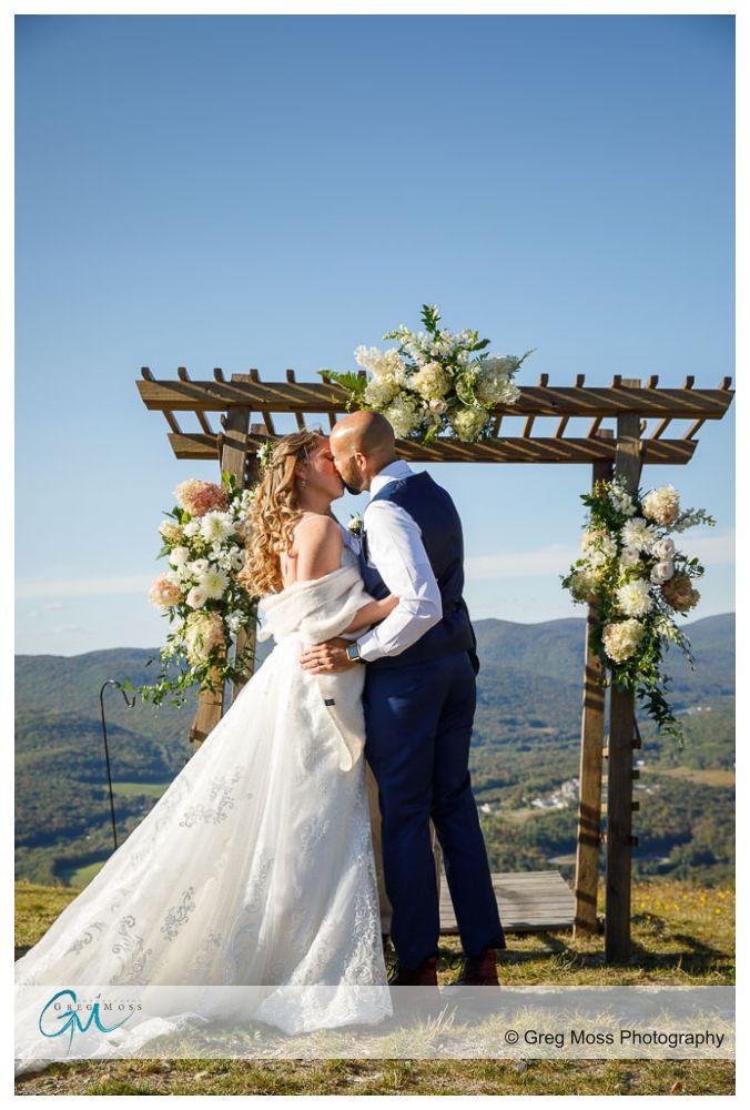 Jiminy peak wedding photography, Bride and groom first kiss