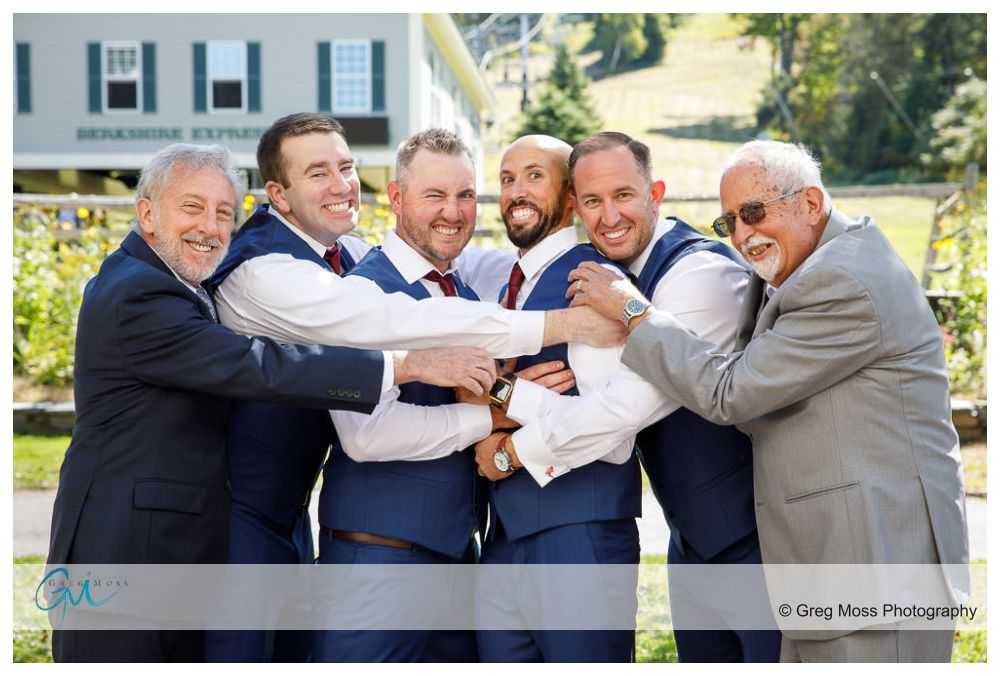 Groom and groomsmen with fathers