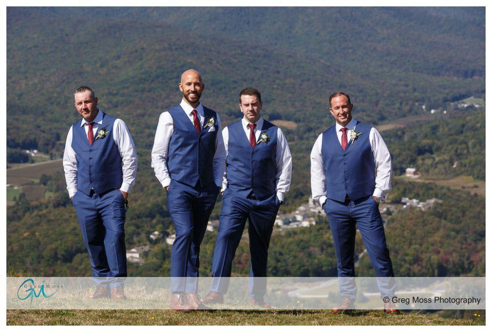 Groom and groomsmen at summit of Jiminy peak