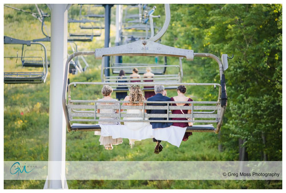 Bride, mother, father and sister riding up chairlift at Jiminy peak