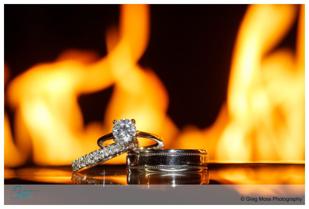 Wedding Rings in front of fireplace